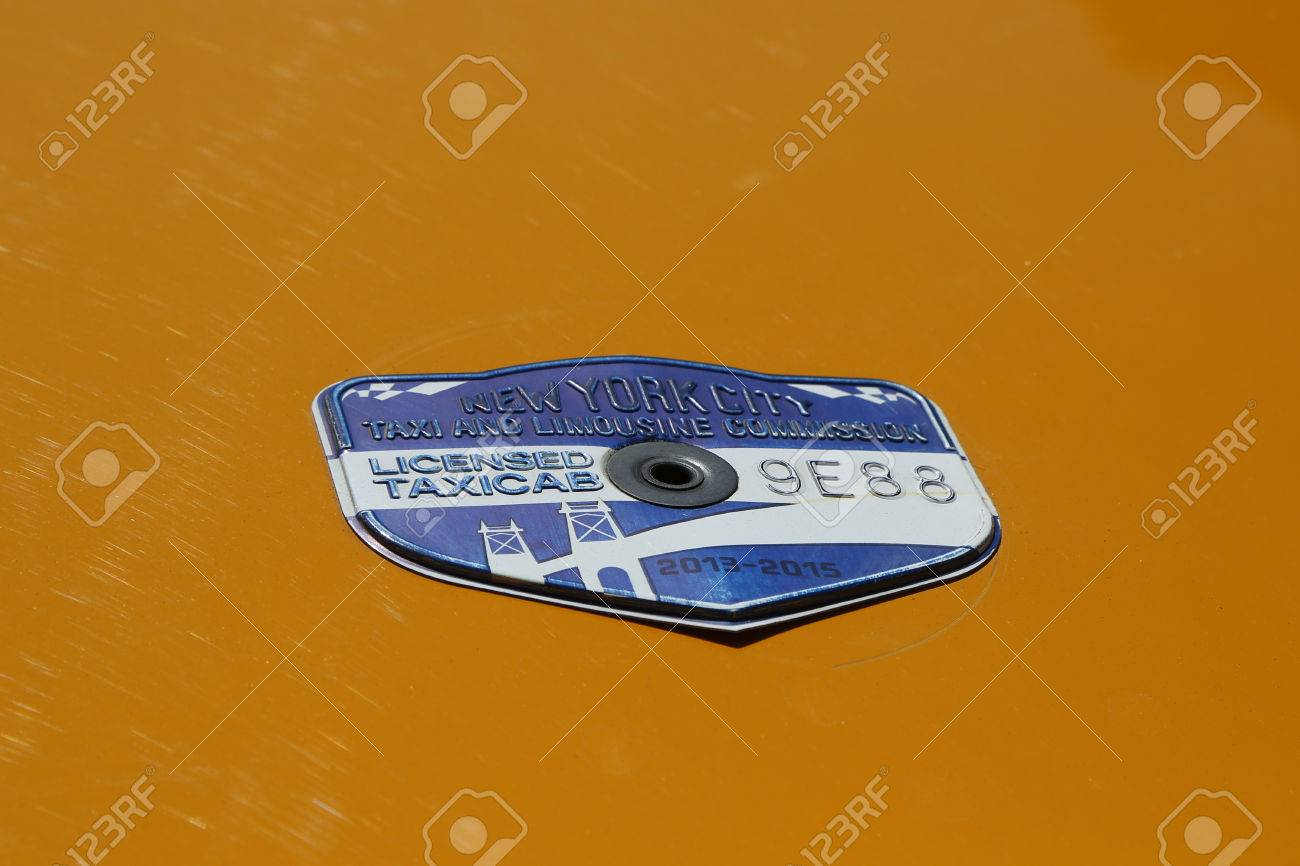 NEW YORK - MARCH 29, 2015: New York City taxi medallion in New