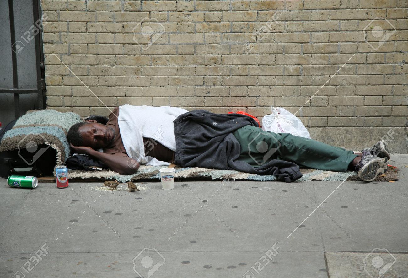NEW YORK - JUNE 16, 2016: Homeless man at Greenwich Village in Lower Manhattan - 58570441