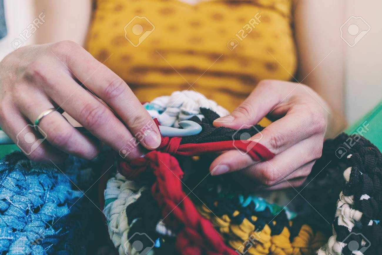 The Woman Is Knitting Crocheted Out Of Thick Yarn Yarn From Stock