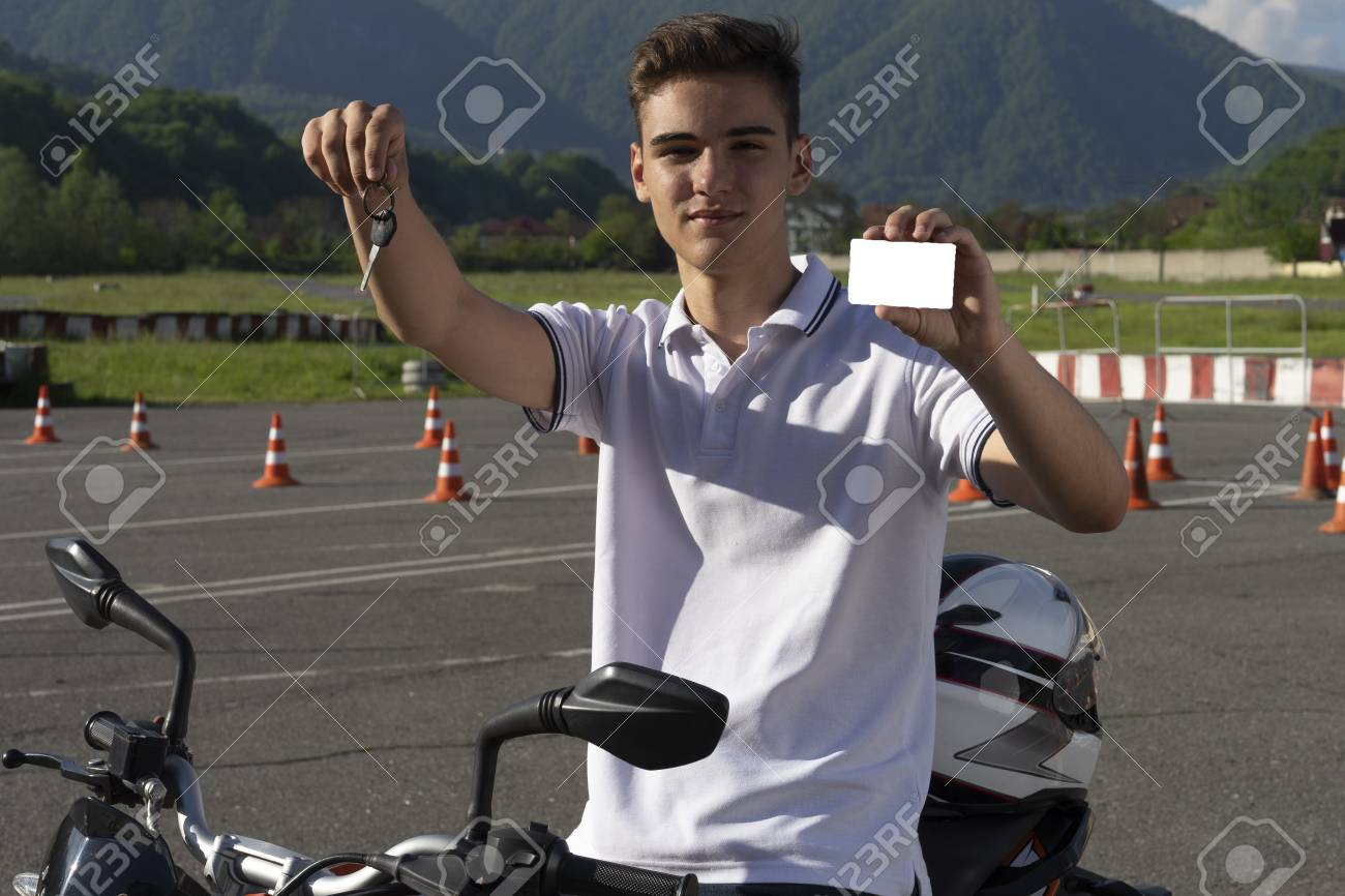 Teen Driving Course >> Teen On The Scooter Is Showing Driving License And Motorcycle