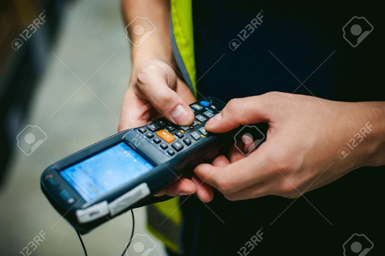 Worker Checking and Scanning Package by tablet handheld In Warehouse. - 67437035
