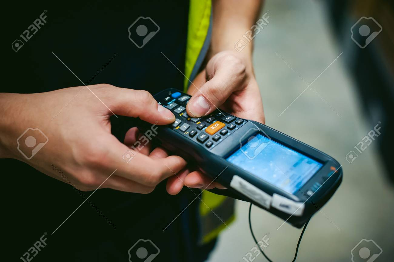 Worker Checking and Scanning Package by tablet handheld In Warehouse. - 71034893