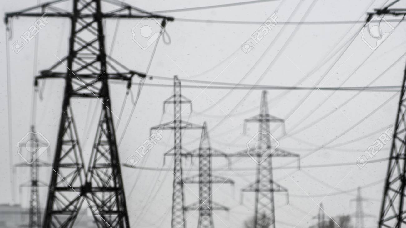 power lines on a blurred background, pollution in the air, gray