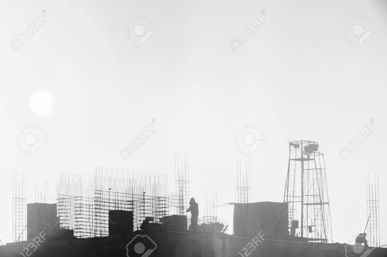 builders working on the construction site, erecting and concrete reinforcement, workflow construction, silhouette - 72861039
