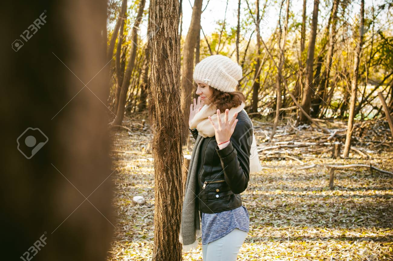 1b45c9849 Young Woman Walks Among The Trees On The Bank Of A Sunny Day ...