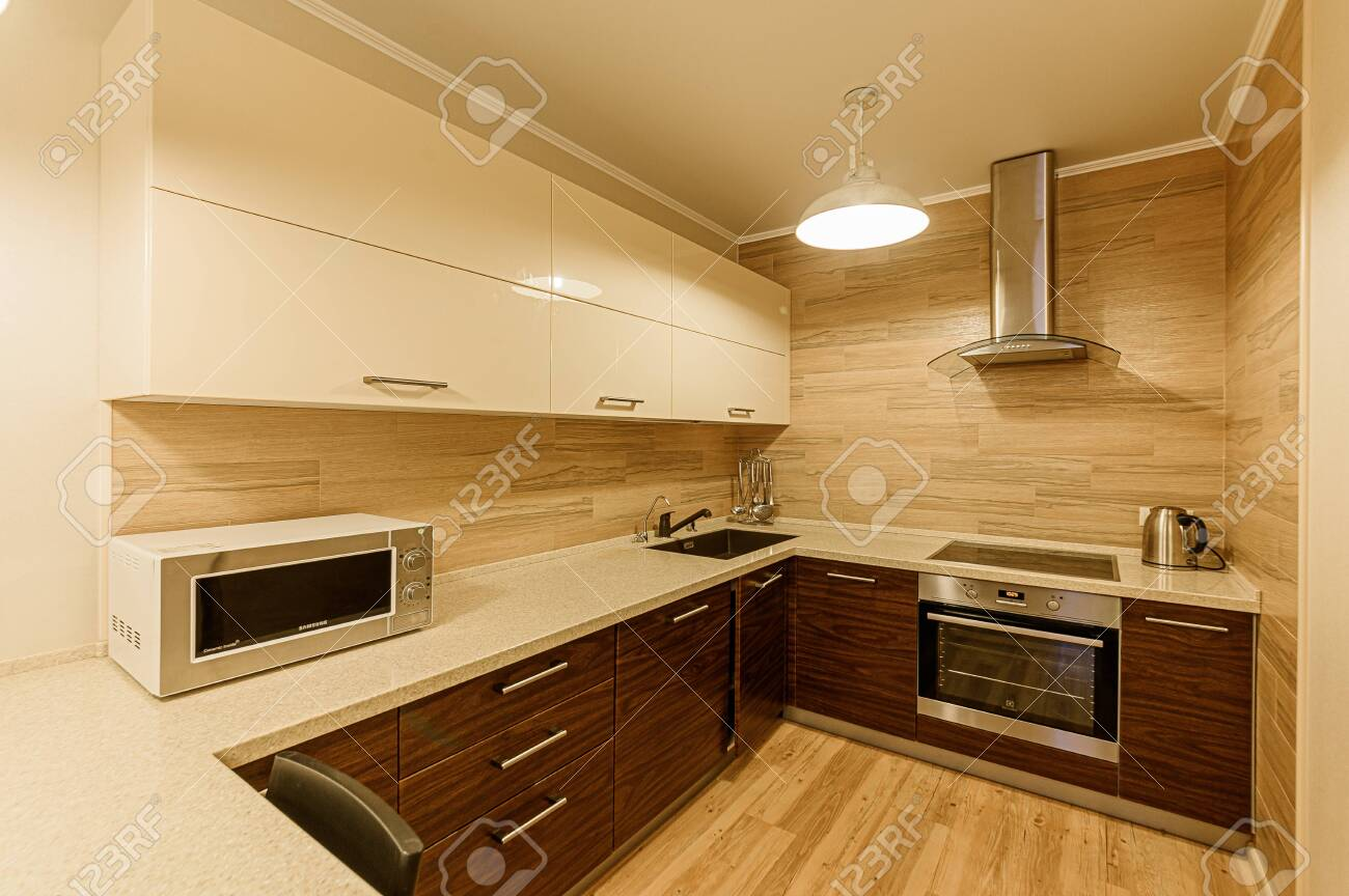 Russia, Moscow- February 07, 2020: interior room apartment modern bright cozy atmosphere. general cleaning, home decoration, preparation of house for sale. kitchen, dining area - 152628299