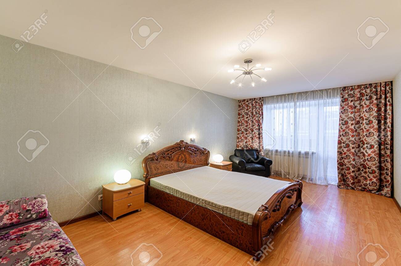 Russia, Moscow- February 10, 2020: interior room apartment modern bright cozy atmosphere. general cleaning, home decoration, preparation of house for sale, bedroom with bed - 152628265