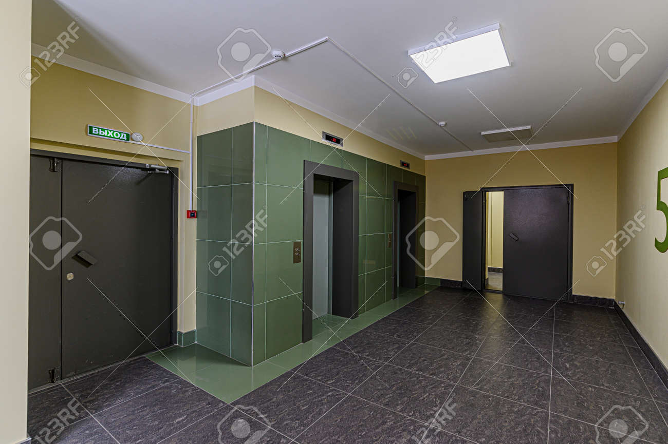 Russia, Moscow- February 07, 2020: interior public place, house entrance. doors, walls, corridors staircase - 152628245