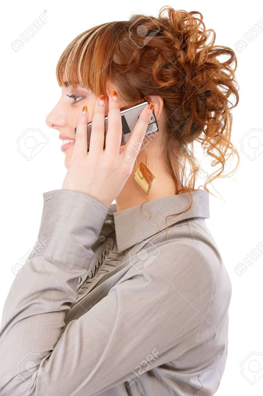 Profile of young woman which speaks by phone, isolated on white background. Stock Photo - 6610135