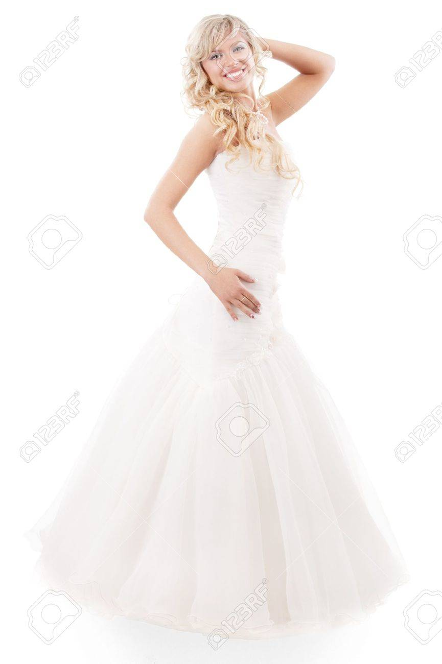 Beautiful woman with long hair wearing luxurious wedding dress, isolated on white background. Stock Photo - 6610091
