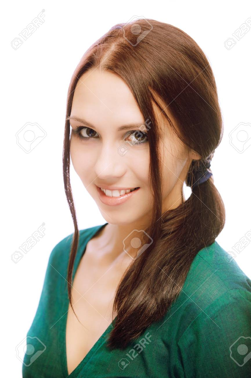Portrait of beautiful young woman in green dress, on white background. Stock Photo - 6879753