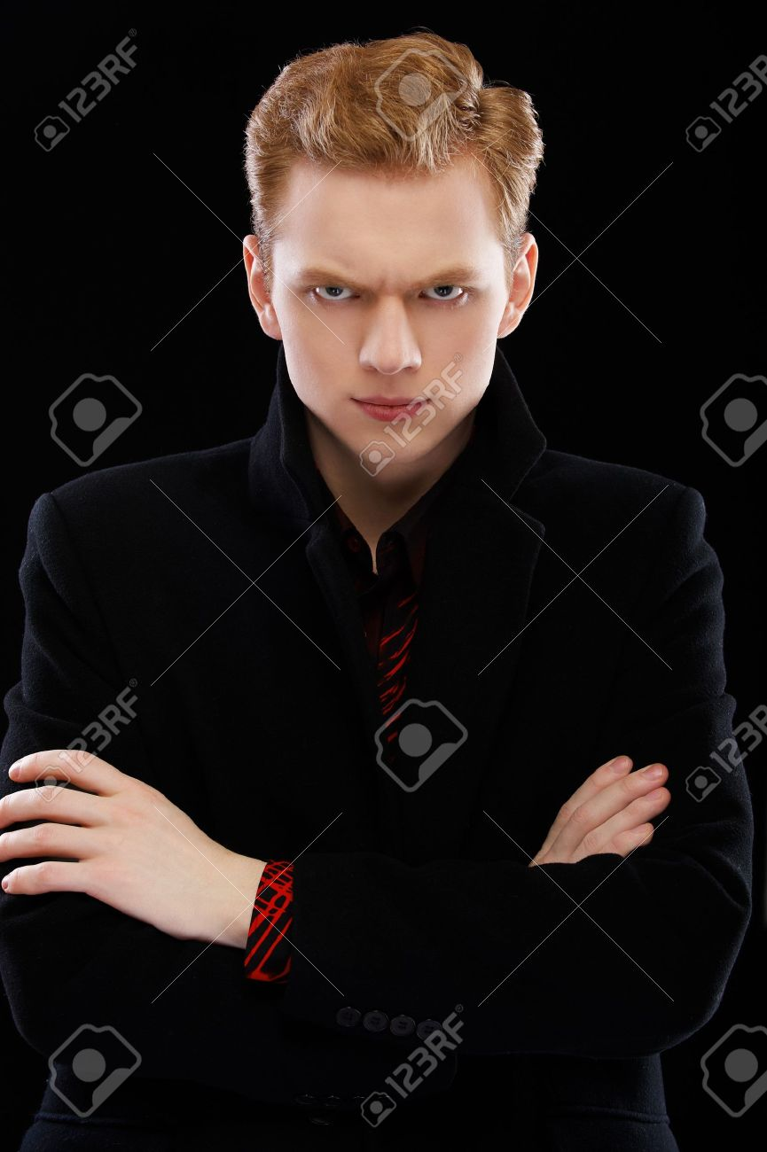 portrait of handsome red-haired guy on black Stock Photo - 7874442