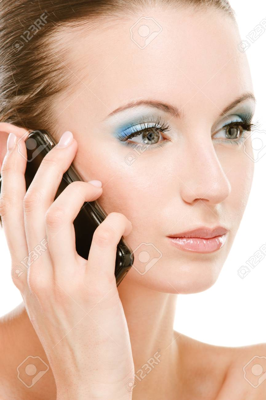 Charming young woman with bared shoulders calls on cellular telephone, on white background. Stock Photo - 8247678
