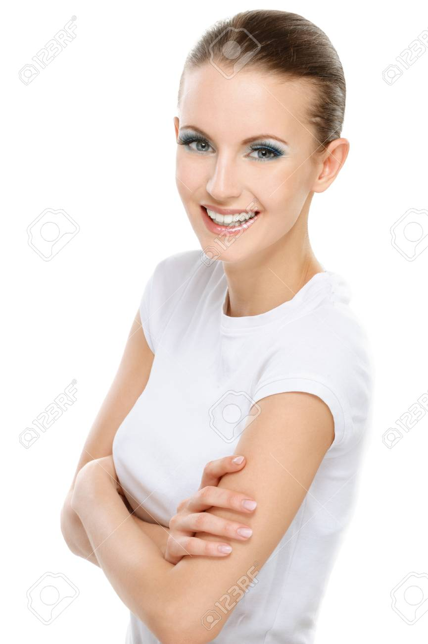Beautiful successful smiling young woman with crossed hands looks confidently in future, on white background. Stock Photo - 8247669
