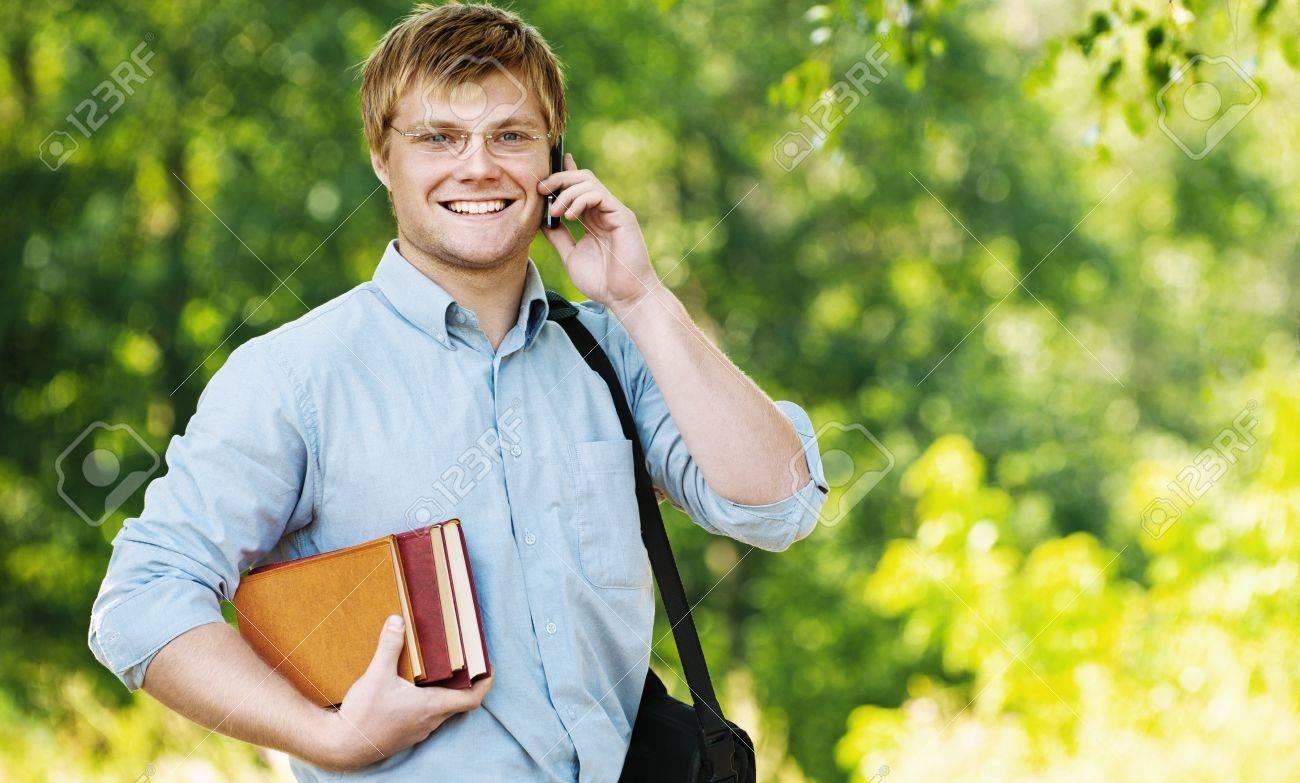 business man wearing glasses bag shoulder talking phone books Stock Photo - 10672629