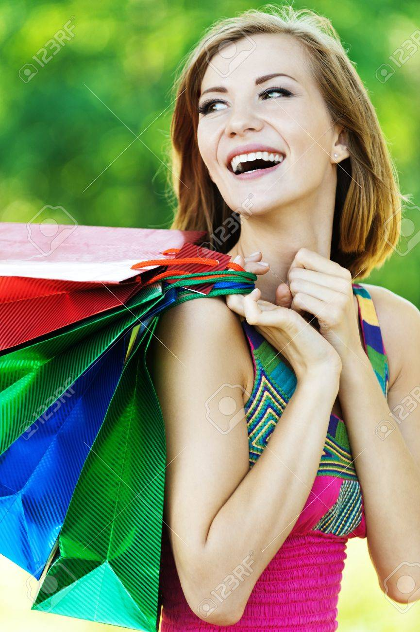 beautiful woman with short hair brunette turned back many packages Stock Photo - 10744317