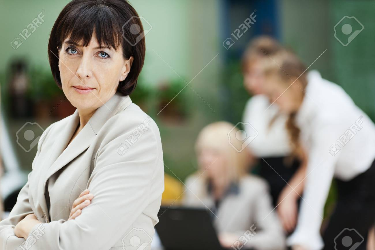 business woman stands behind collective laptop work Stock Photo - 10829397