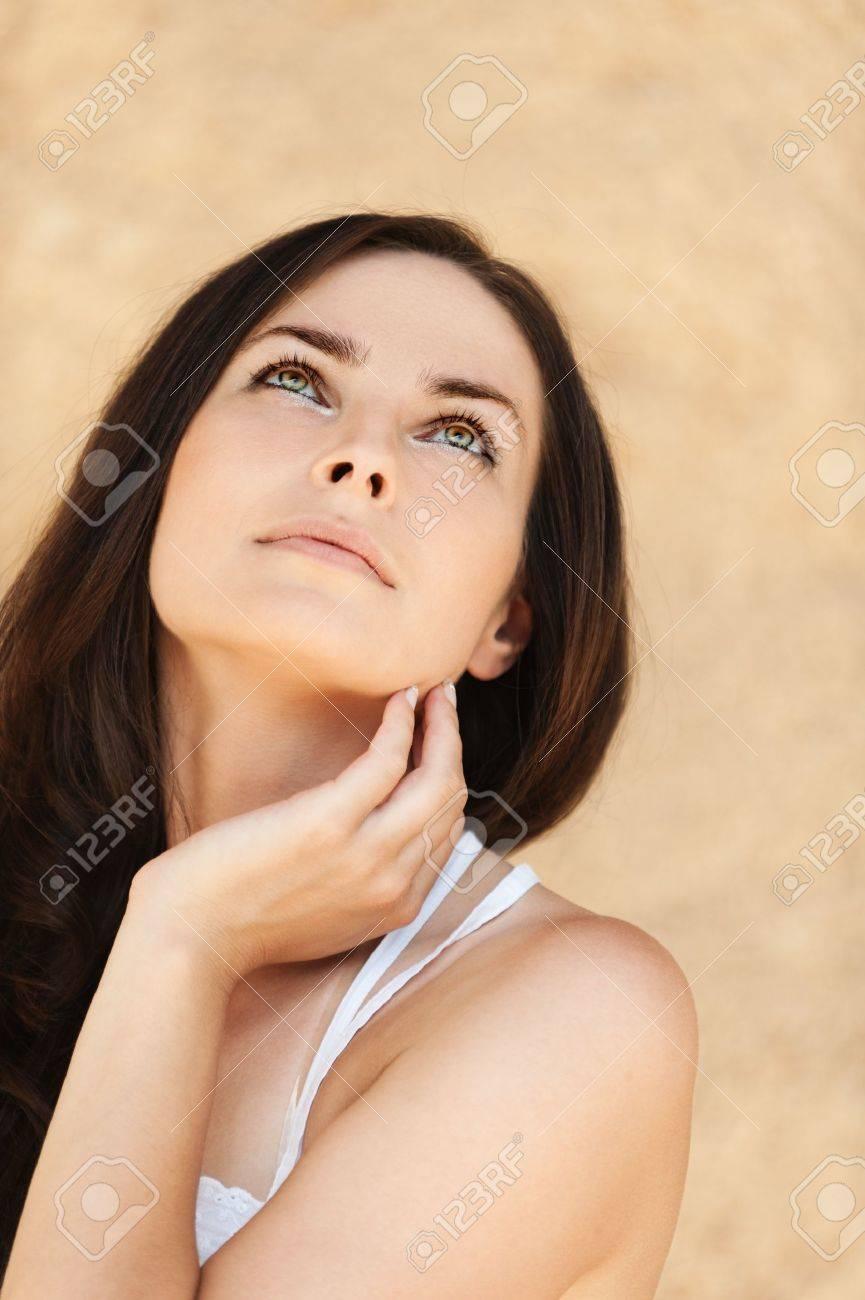 romantic beautiful long dark hair woman looking up Stock Photo - 11032761