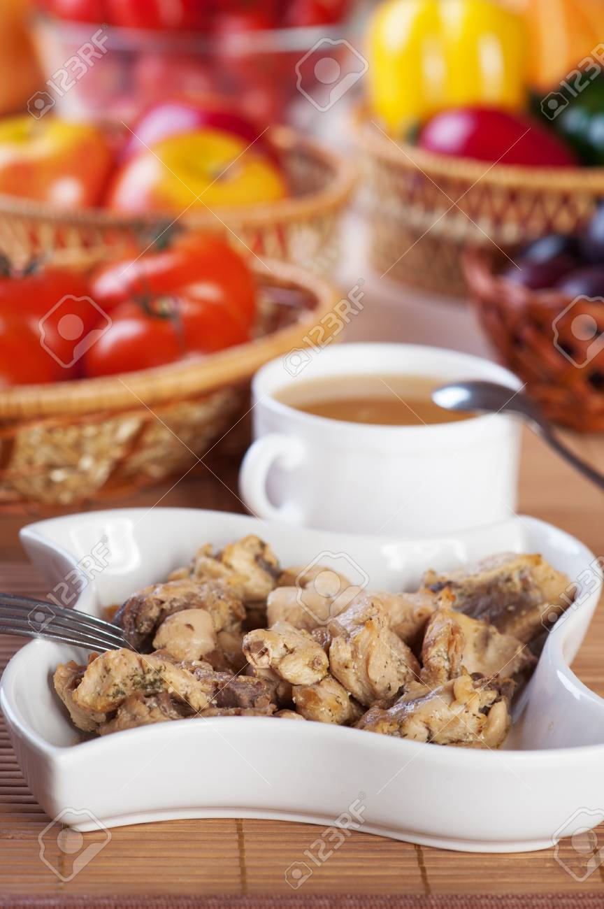 abundance food meat , vegetables, fruits (stewed chicken, tea, tomatoes, peppers, apples, plums) background wooden table Stock Photo - 11254405