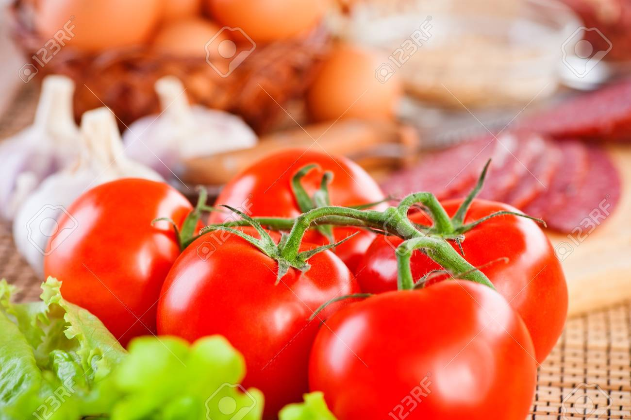 foods (tomatoes, lettuce, garlic, spices,sausage, eggs) Stock Photo - 11254358