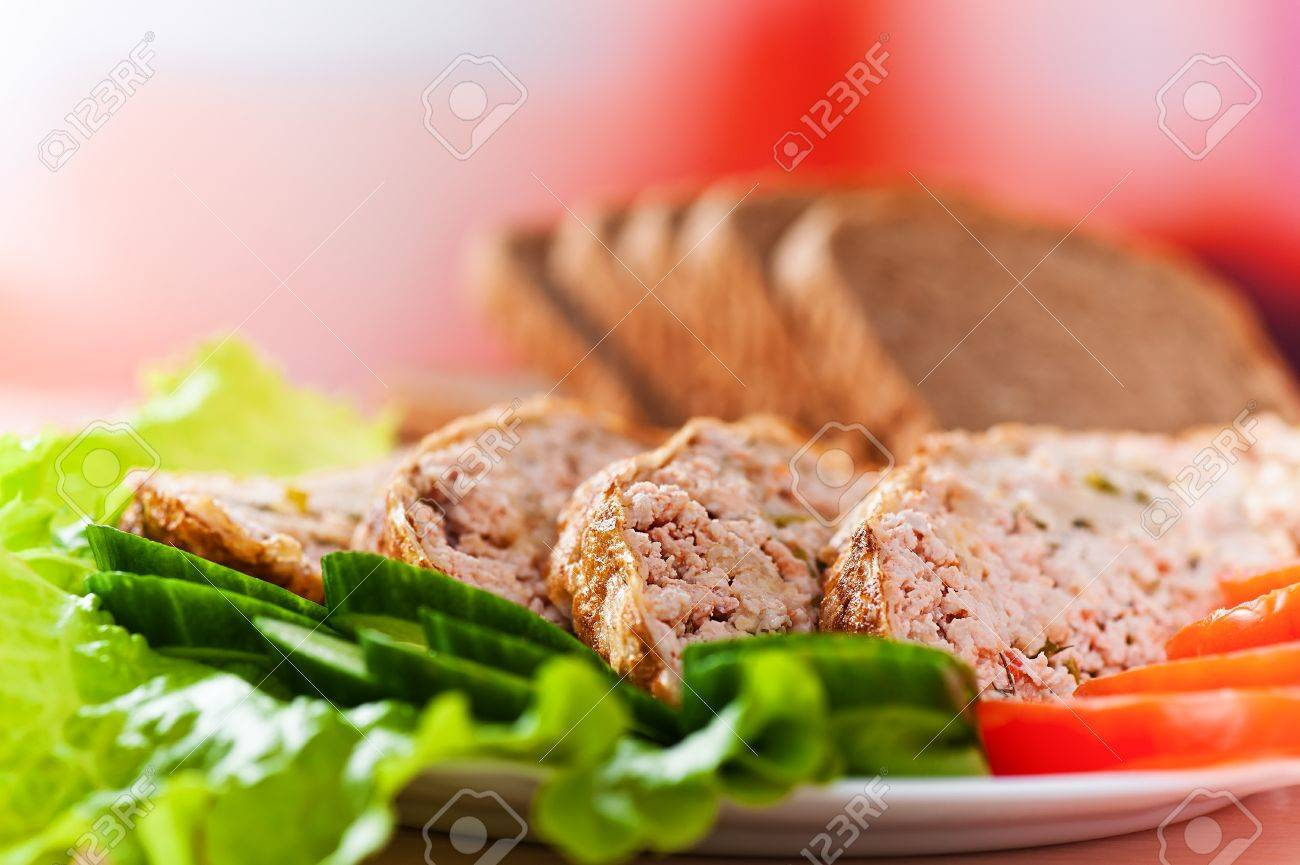 meatloaf with vegetables of cucumber and tomato salad dressed in background sliced ​​rye bread Stock Photo - 11480647
