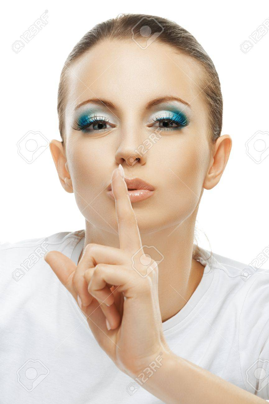 Beautiful dark-haired woman in white T-shirt raised index finger to lips, close-up, isolated on white background. Stock Photo - 16457091
