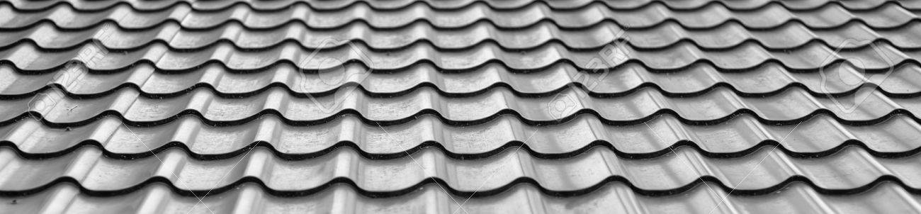 Background of wavy metallic gray tiles for roofing. Stock Photo - 17572293