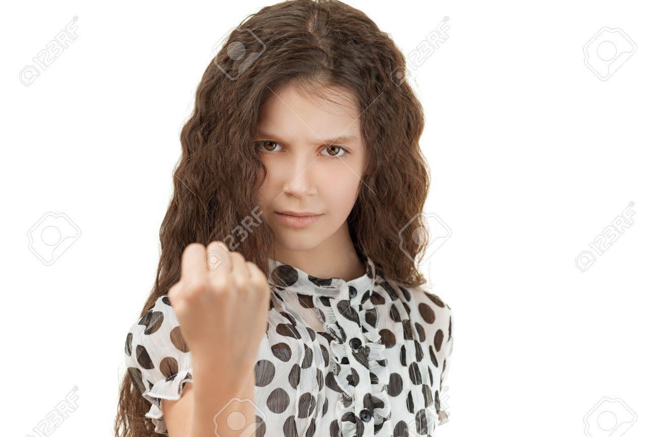 Beautiful sad schoolgirl threatening fist, isolated on white background. Stock Photo - 19536604