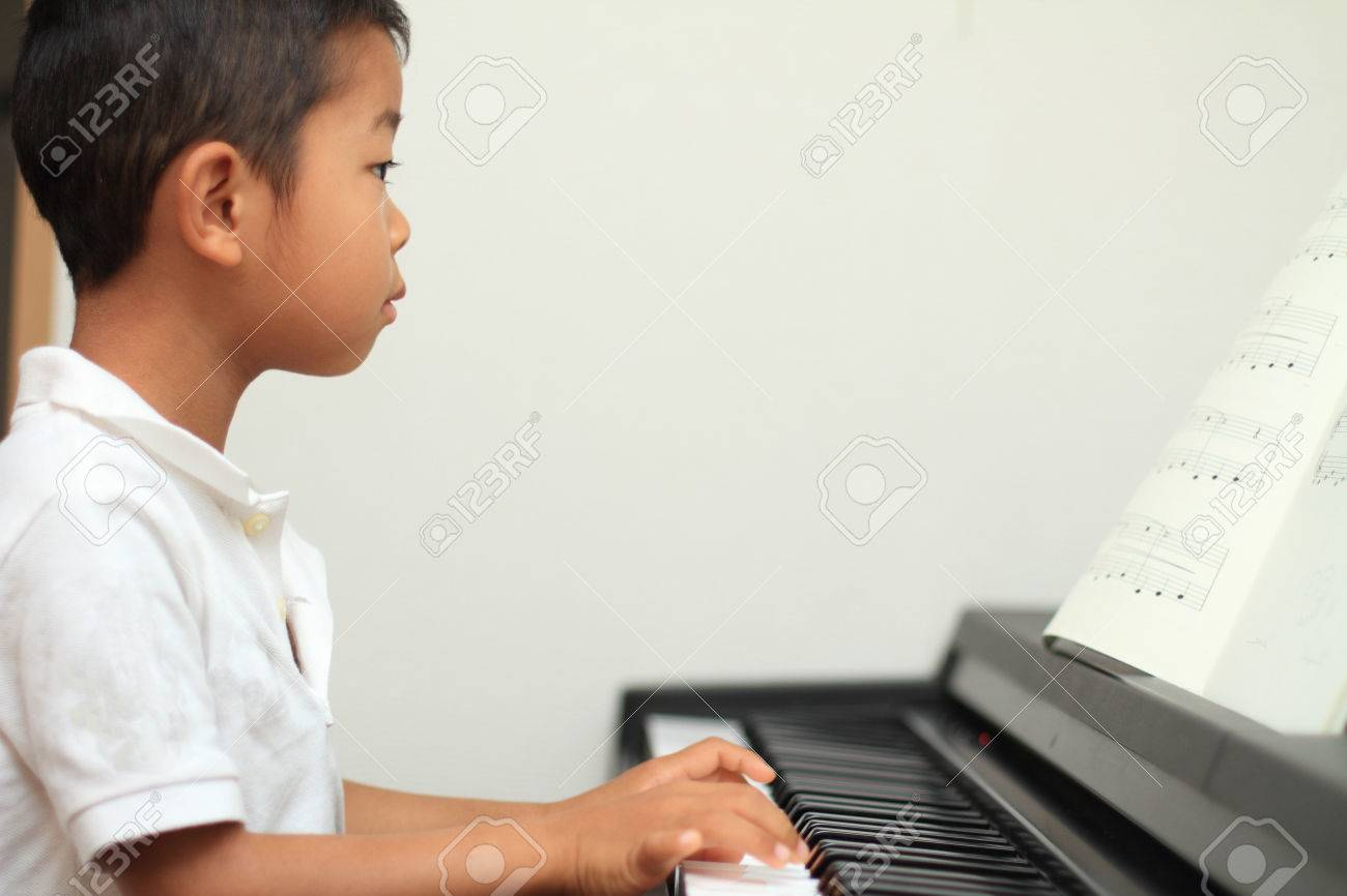 Japanese boy playing a piano (5 years old) - 40635805