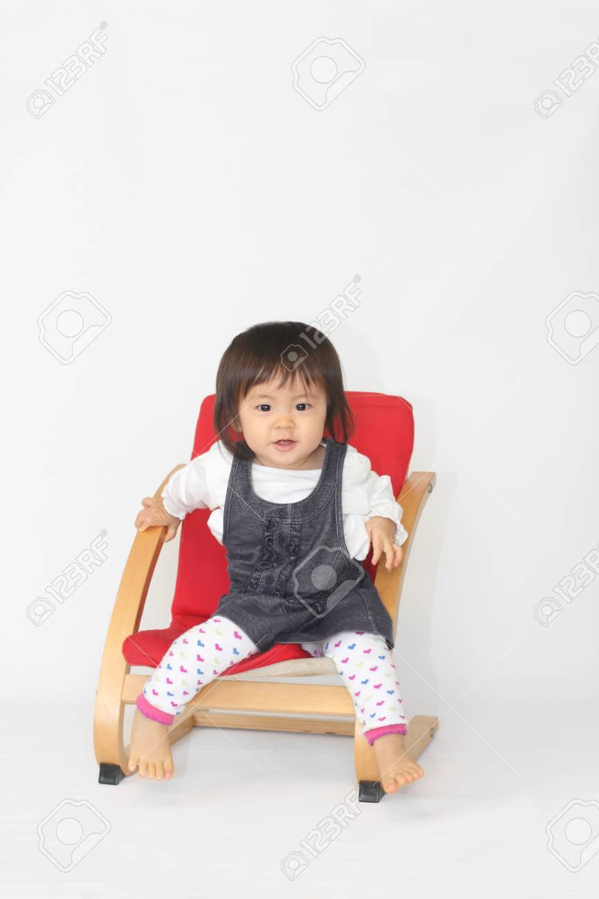 Japanese baby girl sitting on the chair (1 year old) - 50422215