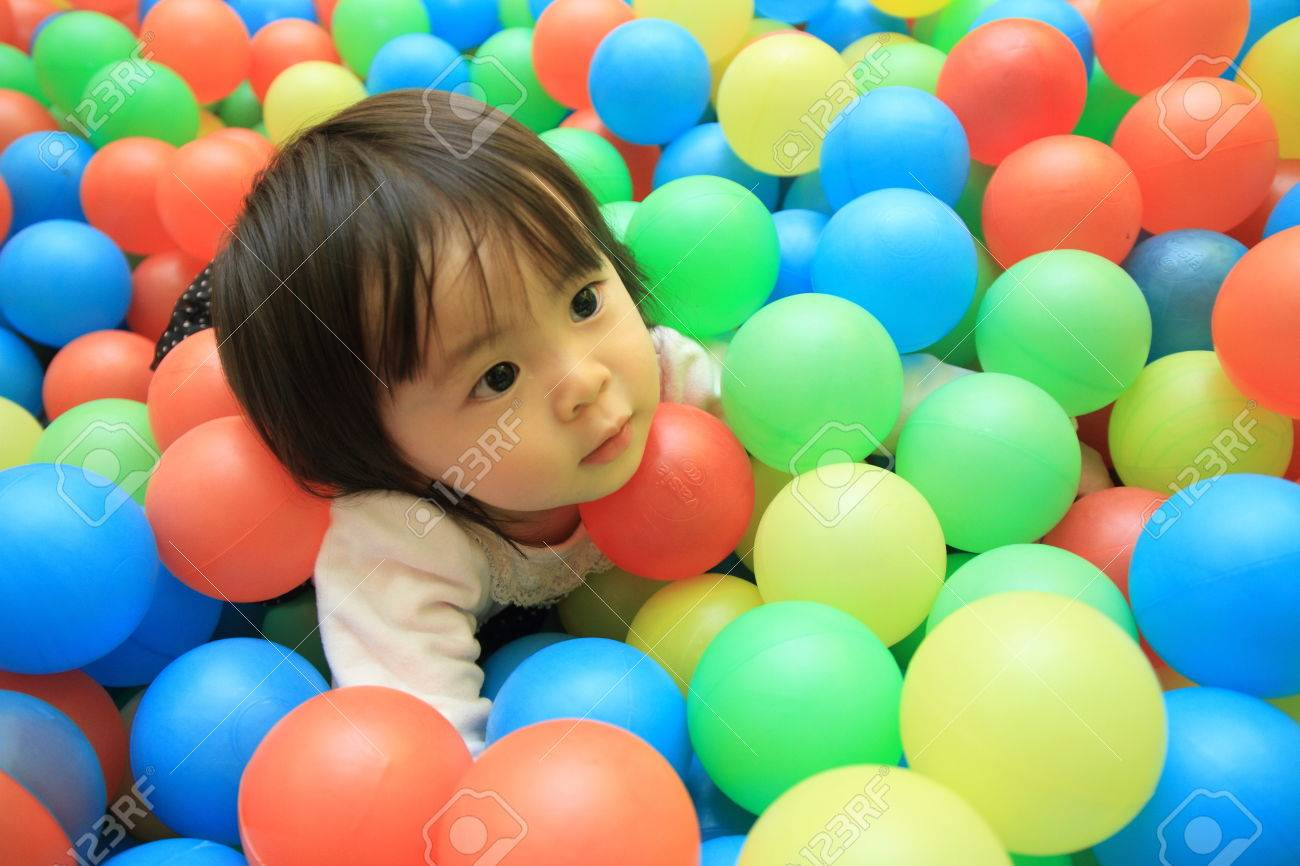 Japanese baby girl playing in ball pool (1 year old) - 53834571