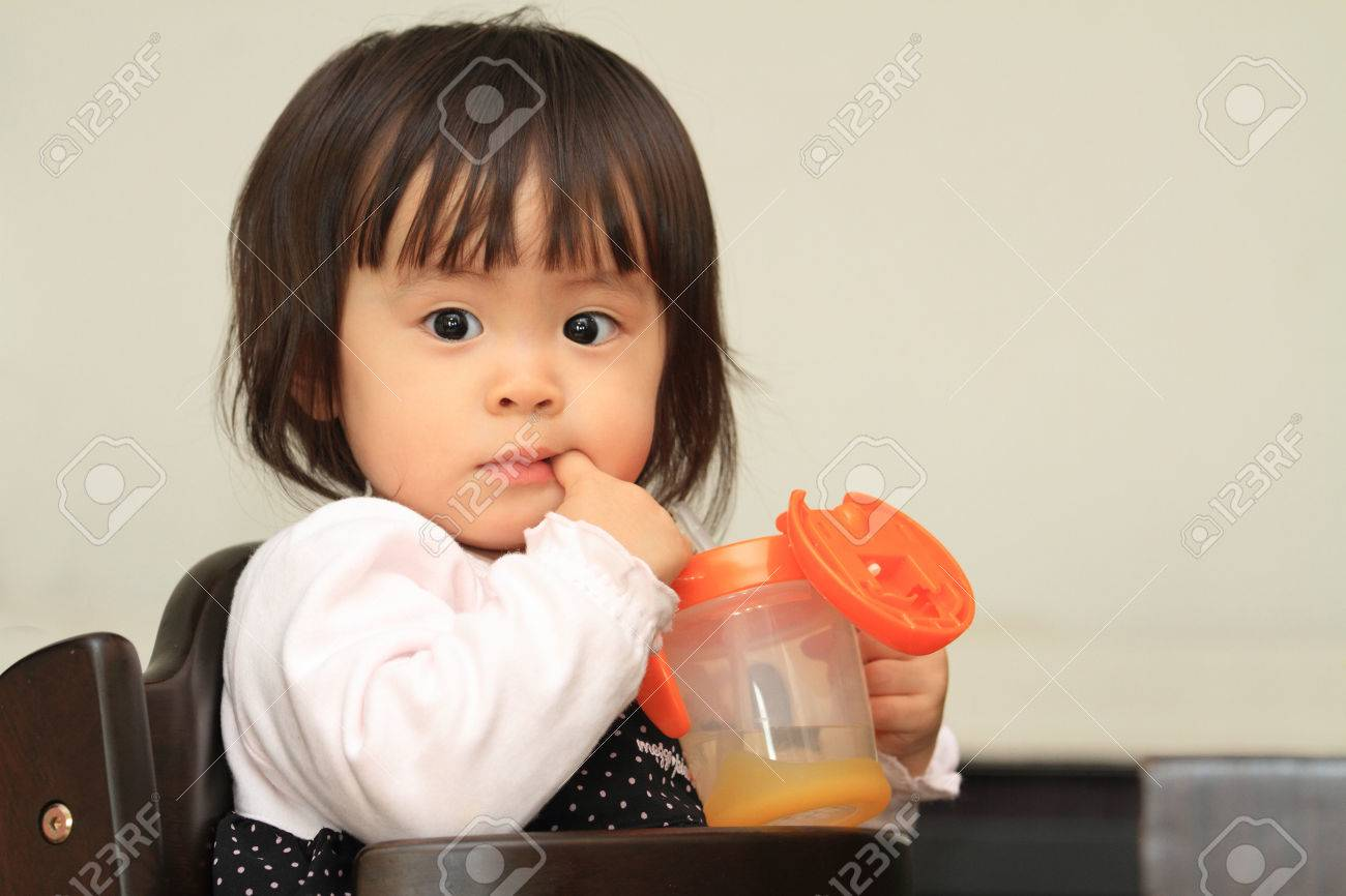 Japanese baby girl drinking water (1 year old) - 54594422