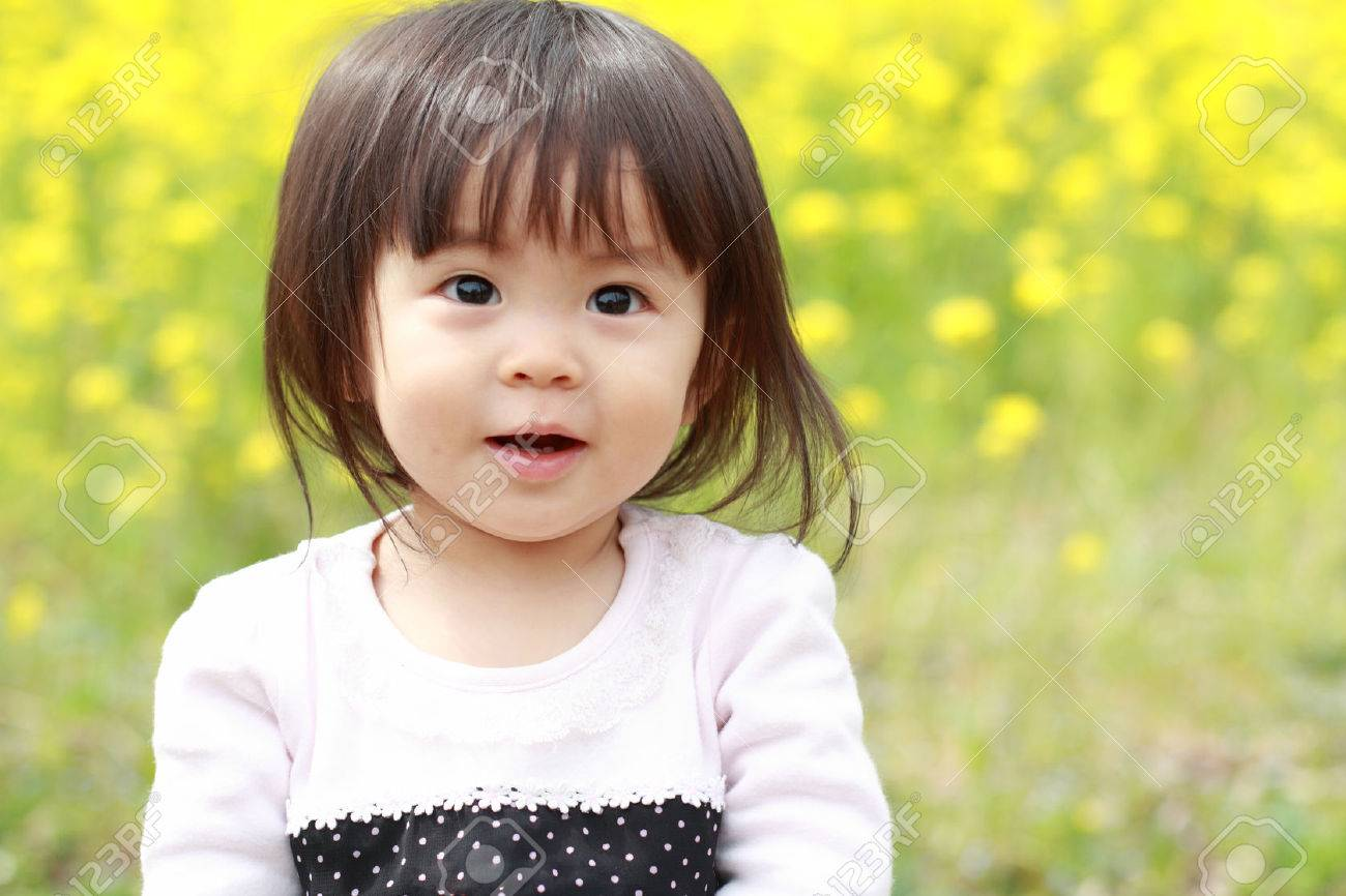 Japanese Baby Girl 1 Year Old And Yellow Field Mustard Stock Photo