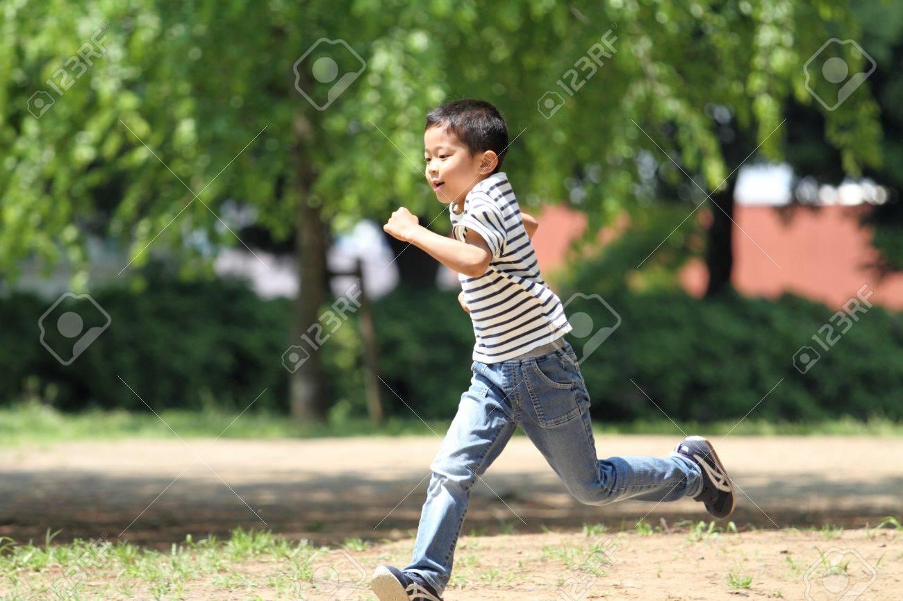 Japanese boy running on the grass?(first grade at elementary school) - 57048214