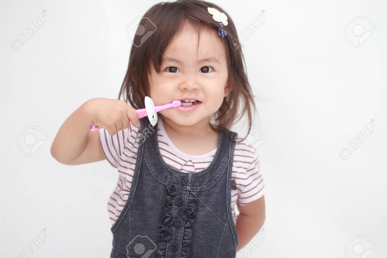 Japanese girl brushing her teeth (1 year old) - 61754906