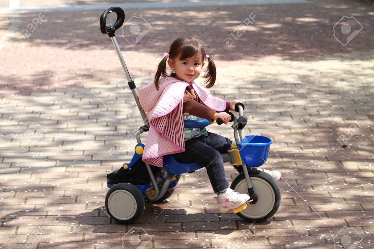 Japanese girl riding on the tricycle (2 years old) - 77577437