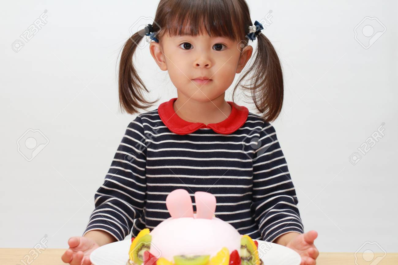 Japanese Girl And A Birthday Cake 3 Years Old Stock Photo