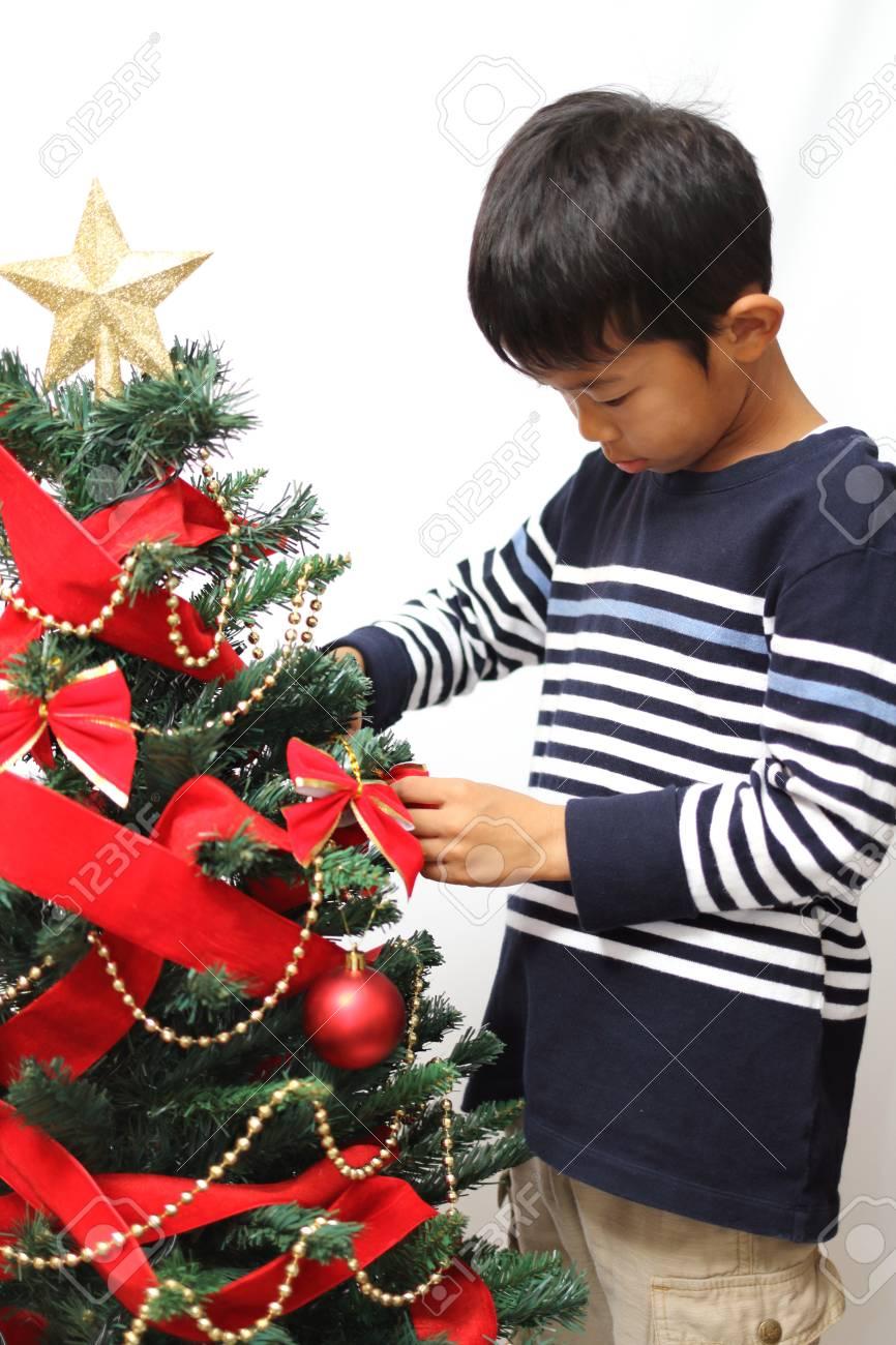 Japanese Christmas Tree.Japanese Boy Decorating Christmas Tree Second Grade At Elementary