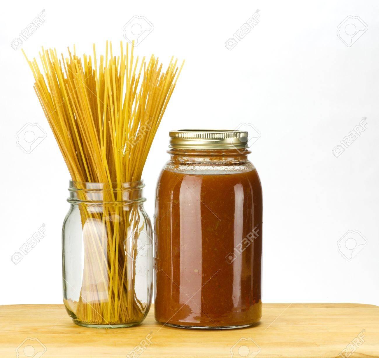 Pasta and homemade tomato sauce in mason jars Stock Photo - 10185662