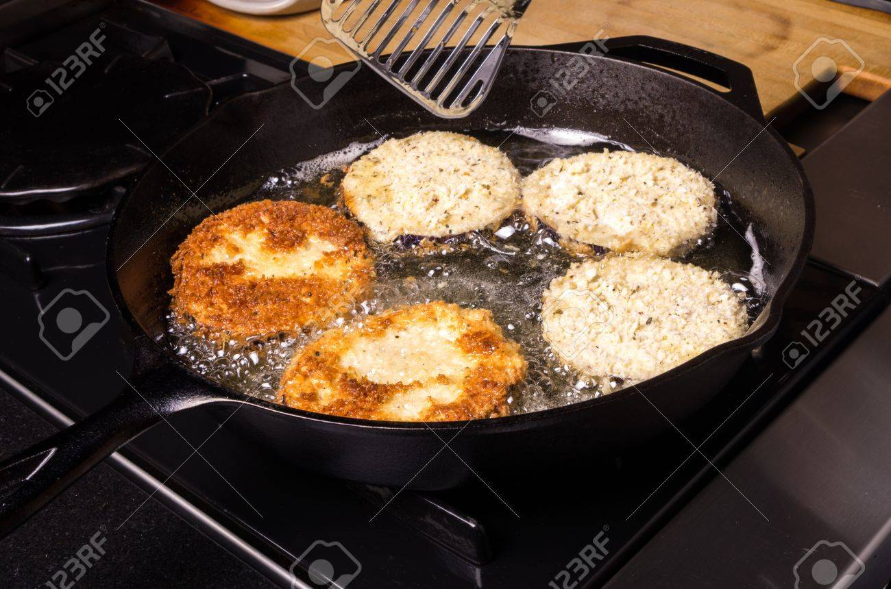 Frying slices of eggplant in cast iron skillet Stock Photo - 15663163