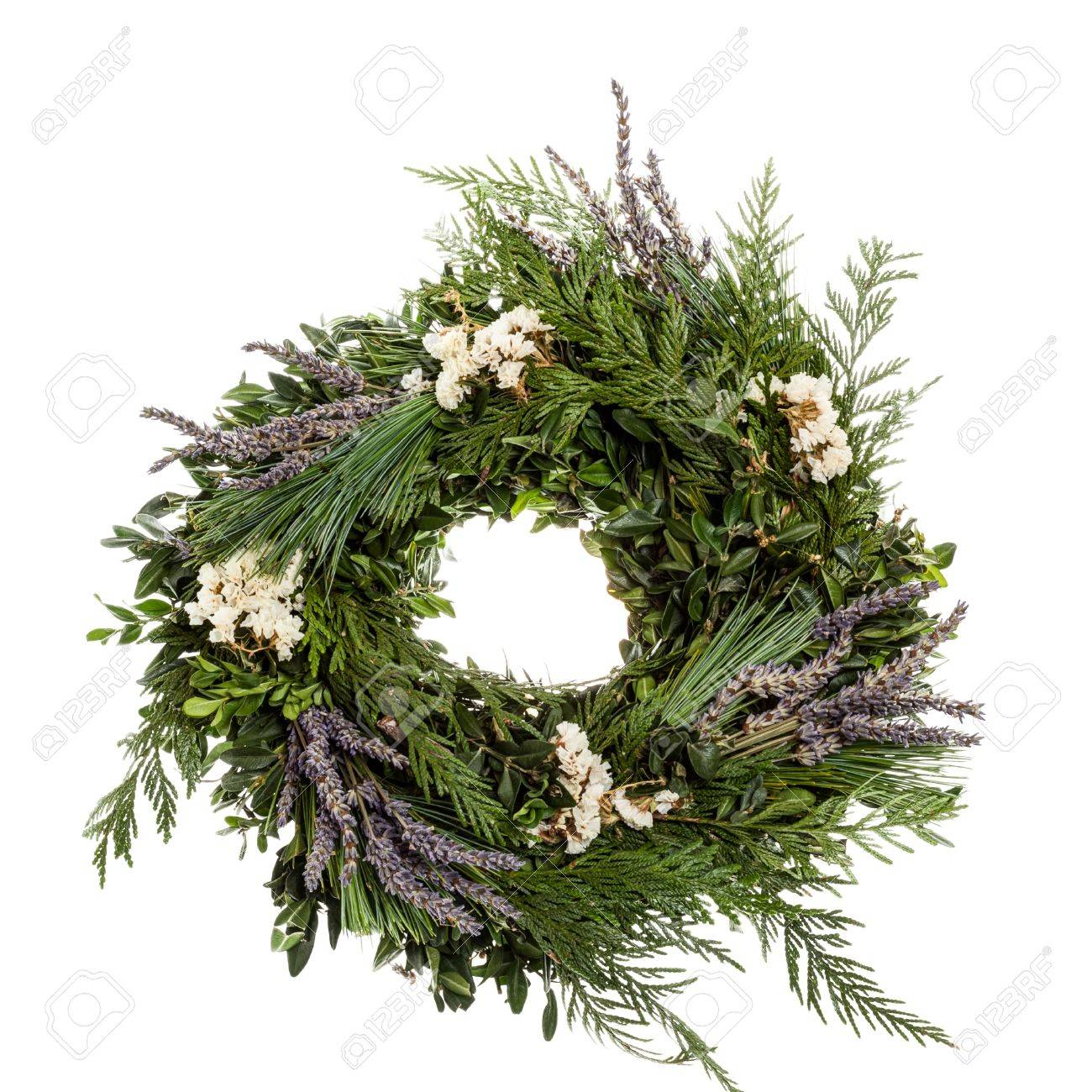 A holiday wreath with greens and lavender flowers Stock Photo - 16882031