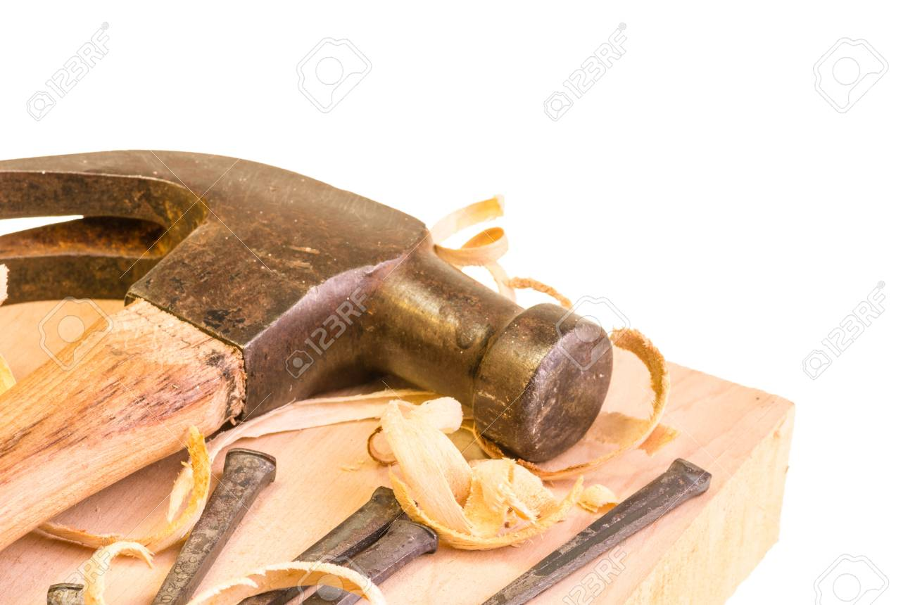 A hammer and nails on a wood board with sawdust shavings Stock Photo - 17453273