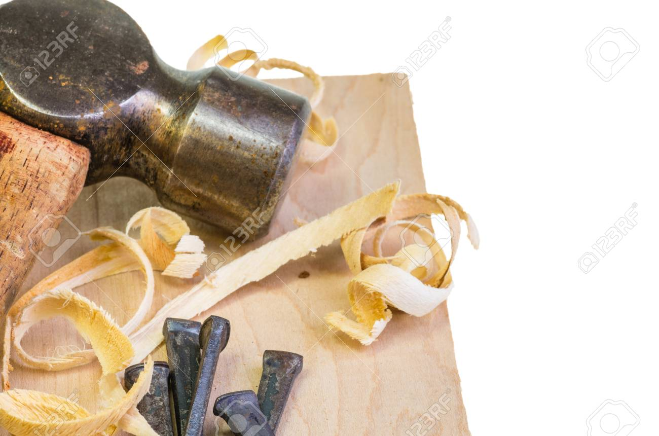 A hammer and nails on a wood board with sawdust shavings Stock Photo - 17571667