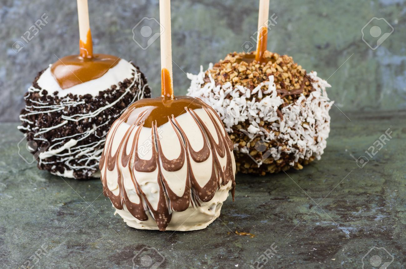 Sweet Chocolate Or Caramel Covered Apples With Nuts Stock Photo ...