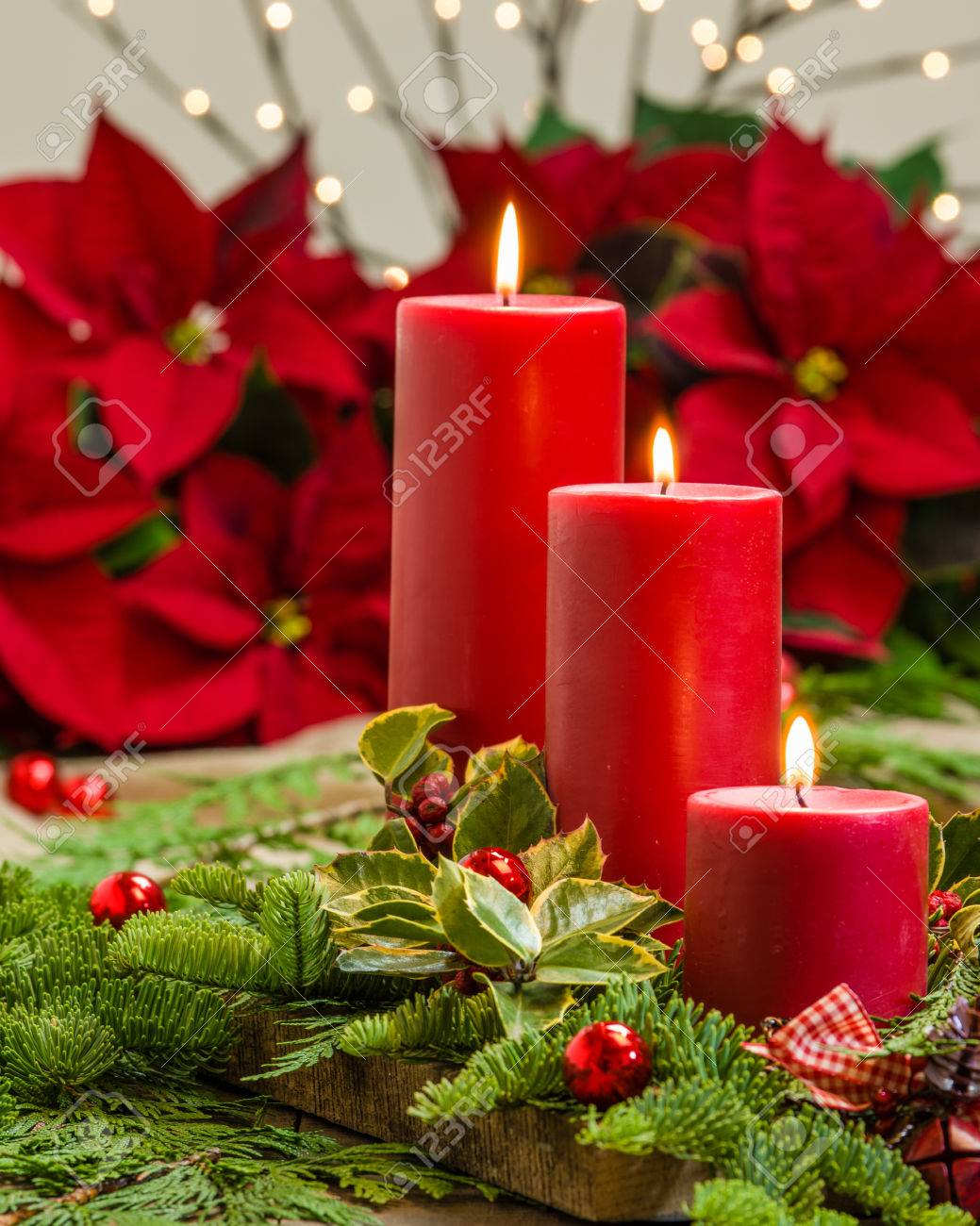 An Evergreen Christmas.Lit Red Candles In An Evergreen Christmas Arrangement