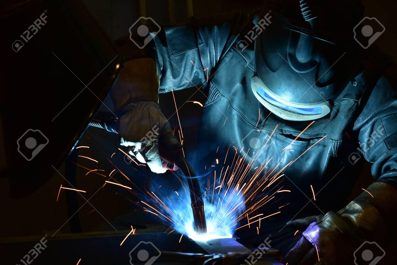 welder, craftsman, erecting technical steel Industrial steel welder in factory - 120612488