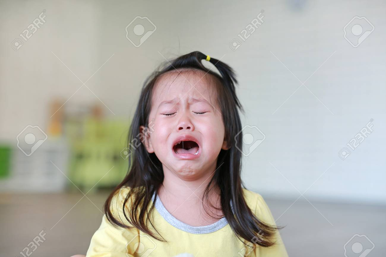 Close up Little kid girl crying with tearful on her face. - 97655567