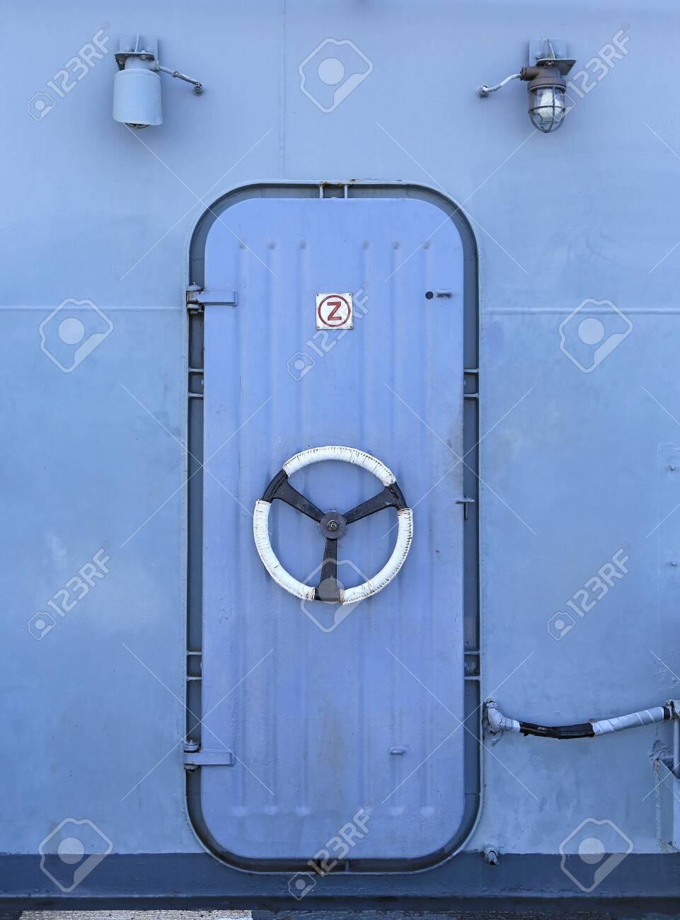 Steel door in the battleship - 127641242