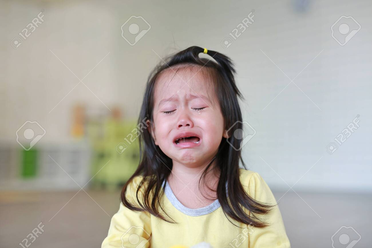 Close up Little kid girl crying with tearful on her face. - 130038667
