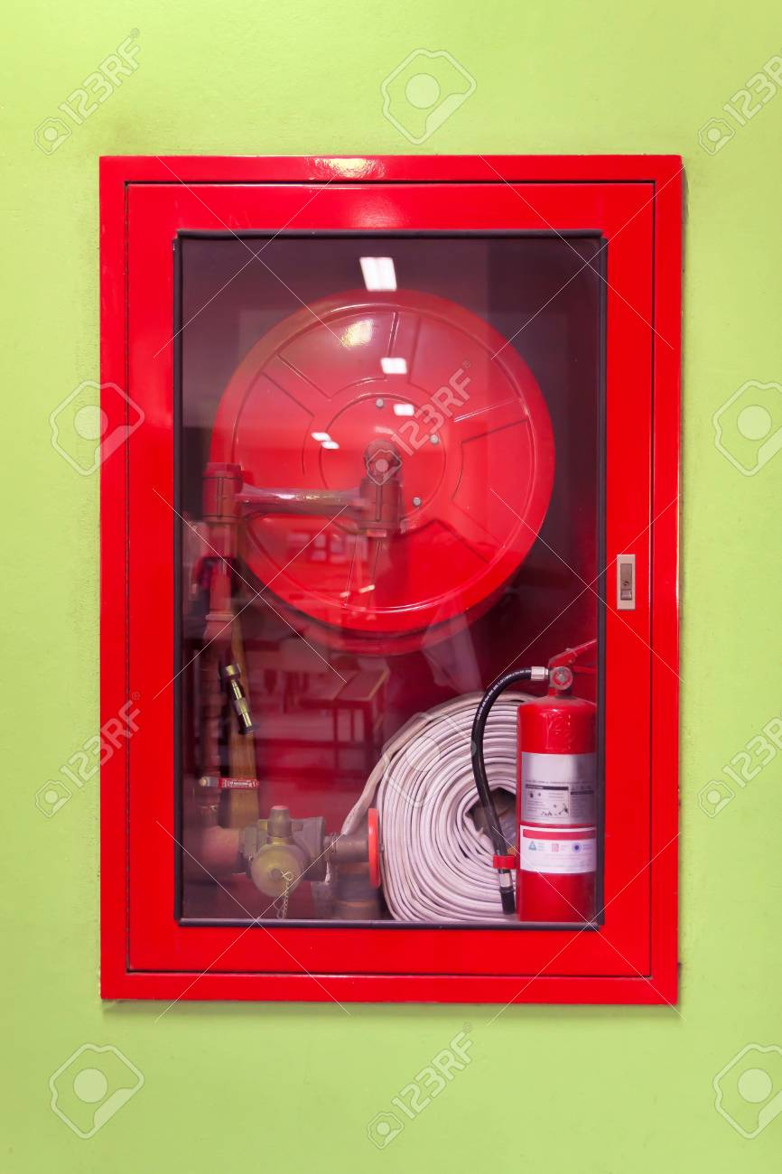 Fire extinguisher and fire hose reel in hotel corridor Stock Photo - 85115817 & Fire Extinguisher And Fire Hose Reel In Hotel Corridor Stock Photo ...